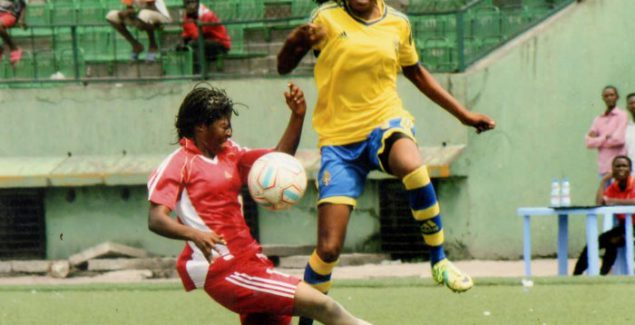 Emérence Girukwishaka, left, in red jersey, displaying her talent on the ground